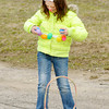 Alexa Owens races to hang Easter eggs to a velcro belt around her waist during intermission on opening night at Anderson Speedway on Saturday. Madison Park Church of God sponsored Easter activities for kids at the race track on Saturday.