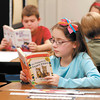 Liberty Christian 3rd graders Emmaline Mercer, foreground, and Tyler Houk, background, read their books during a break in the classroom as they prepare to take the IREAD test Tuesday.