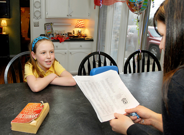 St. Ambrose Elementary School 3rd grader Ellie Fleming works on her words with her mother Erin for the upcoming THB Spelling Bee.