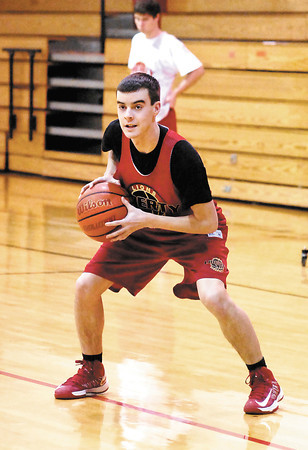 Liberty Christian basketball player Thatcher Rouse works the ball during practice Tuesday.