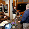 John P. Cleary/The Herald Bulletin<br /> Modern Trailer Sales salesman Shane Renna shows a customer the entertainment center in one of the travel trailers they have in their showroom at their business at 2730 W. 53rd Street in Anderson.  Modern Trailer Sales Inc. was named Madison County's Small Business of the Year by the Madison County Chamber at their annual awards gala Thursday evening.