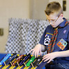 Don Knight / The Herald Bulletin<br /> Porter Wallen puts his car on the track as he competes in the Webelos I division during the Sakima District Cub Scout Pinewood Derby at the Park Place Community Center on Saturday. The cars ran three heats each in all six lanes.