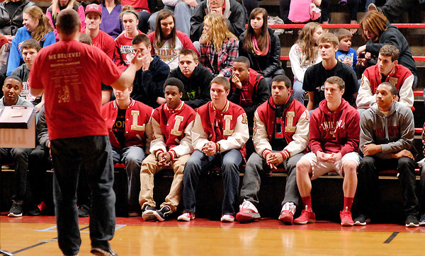 John P. Cleary | The Herald Bulletin<br /> Liberty Christian adult fan Bill Dayton addresses the basketball team as he speaks at the schools celebration of their basketball season Tuesday evening.