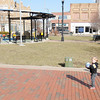 Don Knight / The Herald Bulletin<br /> Jordan Montague, left, his son Jeremiah, right, and Ian Dahmer play with a ball at Town Center Park on Tuesday. The Anderson Park Board passed a resolution to rename Town Center Park for local philanthropists Charles and Hazel Dickmann.