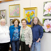 Don Knight / The Herald Bulletin<br /> Floral paintings by 6 members of the Art Association of Madison County are on display at the Visotors Bureau. From left are Carlos Seal, Beverly Mills, Leanor Papai and Patrick Kluesner. Not pictured are Jan Sisson and Jan Trisler.