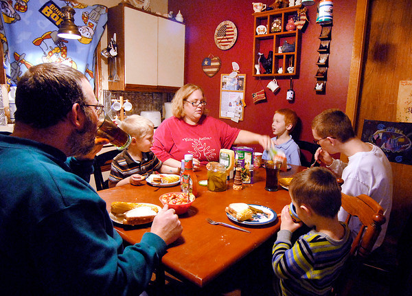 THB photo/John P. Cleary<br /> Every night the Brown family sits down to dinner around 6 p.m. in their small kitchen.  The family, clockwise, is father Steve Brown; Joey, 5; mother Rachel; C J, 7; Jonathan, 15; and Jacob,3.
