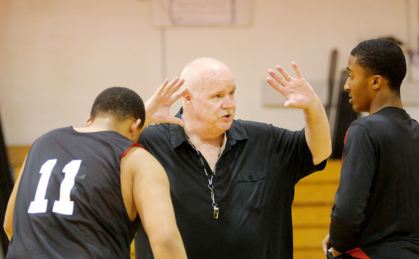 Don Knight / The Herald Bulletin<br /> Liberty Christian assistant coach Mike Carey talks to Quincey Hyatt, left,  and Franklin Nunn during practice on Wednesday as the Lions prepared for their semi-state matchup against Marquette Catholic.