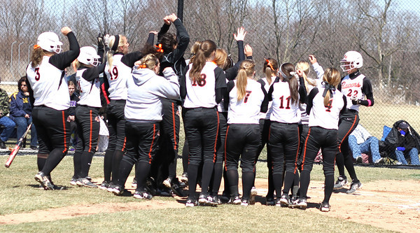Photo by Chris Martin<br /> The entire Ravens team celebrates Nichole Frazier crossing home plate after her first Home Run on Saturday