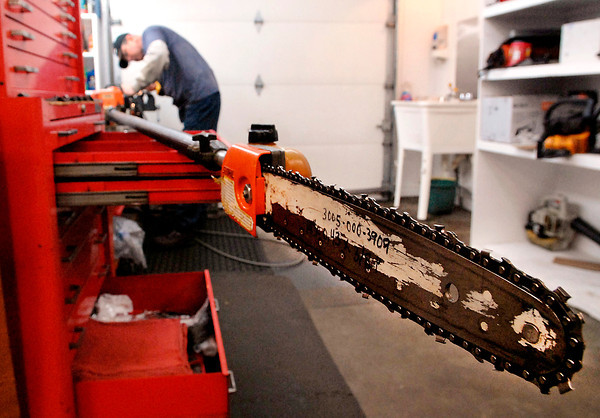 THB photo/John P. Cleary<br /> Jim Corn, of Bindle Lawn Equipment Sales & Service, services this telescoping chain saw preparing it for spring.