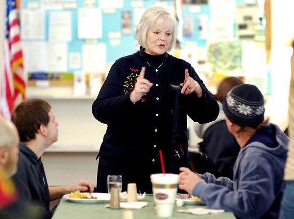 THB photo/John P. Cleary<br /> Patricia Ecker, a volunteer and one of the organizers, talks with some of the diners as they enjoy the weekly free meal furnished by Trinity Episcopal Church.