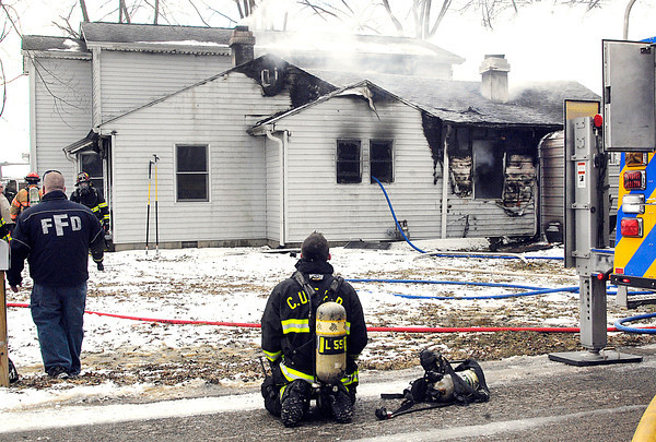 THB photo/John P. Cleary<br /> Firefighters from five fire departments fought a house fire at 141 Amber Drive Wednesday morning.  One person was in the house and escaped unharmed but the fire claimed the lives of four family pets.