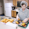 """Don Knight / The Herald Bulletin<br /> LifeStream's Mariena Crull serves lunch at Longfellow Plaza on Friday. March has been designated by the Academy of Nutrition and Dietetics as """"National Nutrition Month."""""""