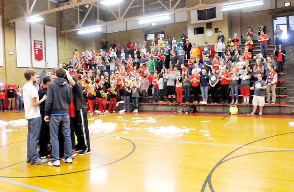 Don Knight / The Herald Bulletin<br /> Liberty Christian's basketball team huddles up at center court at the end of a pep rally on Friday.