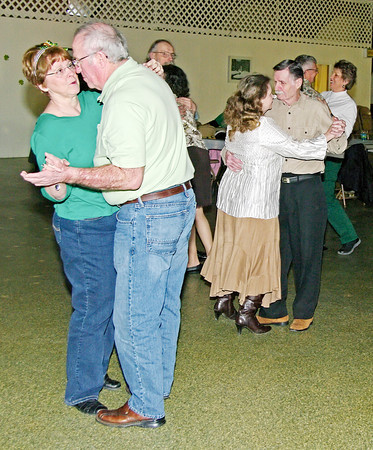 Mark Maynard / For The Herald Bulletin<br /> Janis and Everett Stamper and Carol and Jess Skinner dance to the music provided by local DJ Buddy Patterson at the Rangeline Community Center Saint Patrick's Day dance on Saturday.