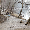 John P. Cleary / The Herald Bulletin<br /> A lone hiker walks along White River on trail 5 at Mounds State Park Saturday.  The Robert Cooper Audubon society says the construction of the proposed Mounds Lake reservoir would exact a heavy cost to the natural environment of the park with loss of shaded hiking trails along the river and the destruction of the Mounds Fen Nature Preserve.