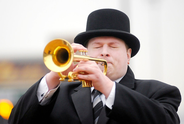 Don Knight | The Herald Bulletin<br /> Hoosier Park bugler Mason Chappell trumpets the call to the post before the start of standard bred racing at Hoosier Park on Saturday. Thursday is the next day for live racing at Hoosier Park.