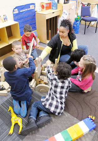 Don Knight / The Herald Bulletin<br /> Rachel Brooks-Steele and her students play with wooden blocks at Head Start in Anderson on Wednesday. Head Start is holding an open house at their new location on April 4th.