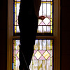 John P. Cleary / The Herald Bulletin<br /> Reta Holdcraft paints the trim around one of the stain glass windows in the Summitville United Methodist Church sanctuary.