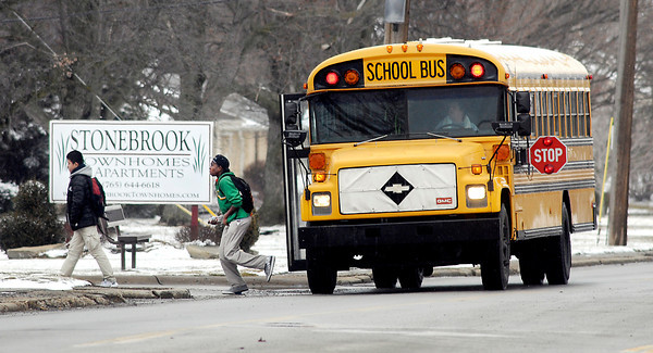 John P. Cleary / The Herald Bulletin<br /> This ACS school bus drops students off along Columbus Ave. Wednesday afternoon after school. Anderson community School officials are proposing a six-point plan to cut transportation costs about $1.5 million starting this year.