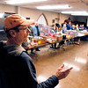 John P. Cleary / The Herald Bulletin<br /> Phil Sveum, volunteer pantry manager for St. John's Evangelical Lutheran Church's Helping Hands Food Pantry, addresses the volunteers before they start their bi-monthly distribution of food.