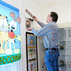 Don Knight | The Herald Bulletin<br /> Fairmount Historical Museum President Cole Reeves adds a photo to the Garfield room as the museum prepares for its opening on April 1st.