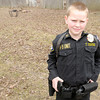 Don Knight / The Herald Bulletin<br /> Trey Edens, 10, wears his Elwood police uniform. Edens has wanted to be a police officer for as long as he can remember.