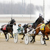 Don Knight | The Herald Bulletin<br /> Peter Wrenn drives Fantasypan (6) to an early lead as he is followed by James Yoder driving River N Onions (4) and Brad Hanners driving Nine Innings (1) in the second race at Hoosier Park on Saturday.
