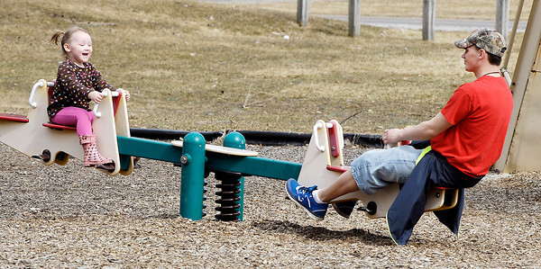 John P. Cleary / The Herald Bulletin<br /> With temperatures into the sixties people got out to enjoy the nice weather like Mylah Webb, 3, who was liking her dad's, Dustin Webb, effort to keep her bopping up and down on the teeter-totter in the Shadyside Park playground Tuesday  afternoon.