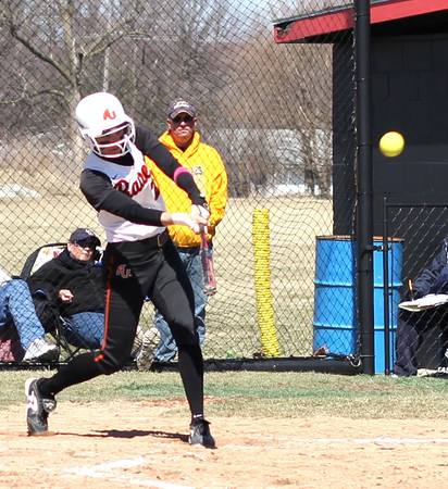 Photo by Chris Martin<br /> Ravens Short Stop Nichole Frazier hits her 2nd Home Run Saturday in a win against Franklin College