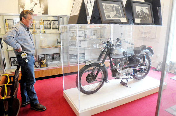Don Knight   The Herald Bulletin<br /> Fairmount Historical Museum President Cole Reeves looks at James Dean's Triumph motorcycle back on display at the Fairmount Museum after being on display at the Indiana State Museum last year.