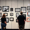 John P. Cleary/The Herald Bulletin<br /> Michelle Beadle and Rob Pool look over some of the art work that is on display at the Art Association of Madison County's 15th annual Student Art Exhibit at the Mounds Mall.