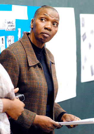 THB photo/John P. Cleary<br /> Schneida Burgess, librarian/teacher at Edgewood Elementary School, checks the program during the school's Black History Month program Friday.