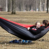 John P. Cleary / The Herald Bulletin<br /> Hollis VanFossen, an AU freshman, and Mark Garrett, an AU sophomore, enjoy the fresh air and warm sunshine, as well as each others company, in this cozy hammock Monday afternoon on the university campus. With temperatures up to around 60 degrees people were ready to get outside and enjoy the weather.