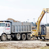 Don Knight / The Herald Bulletin<br /> A Gerry Construction Services dump truck is loaded at the site of the former Days Inn that was demolished to make way for new development and a traffic circle on 59th Street.