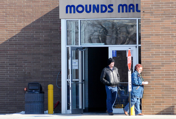 Don Knight / The Herald Bulletin<br /> The back entrance to Mounds Mall displays signs asking visitors to not bring in weapons or backpacks and to lower their hood if wearing a hoodie.