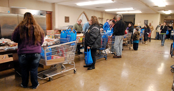 John P. Cleary / The Herald Bulletin<br /> The line is long as the Helping Hands Food Pantry helps about 400 people each time they open their doors.