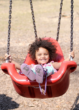 Don Knight / The Herald Bulletin<br /> Camdyn Williams, 2, sits in a swing at Shadyside Park on Friday. The park was full of families taking advantage of the sunshine and temperatures in the 60s.