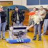 Don Knight / The Herald Bulletin<br /> Madison County's Team Roboto 447 demonstrates last years robot during the Sakima District Cub Scout Pinewood Derby at the Park Place Community Center on Saturday. The team consists of students from across the county.