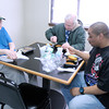 Don Knight / The Herald Bulletin<br /> From left, Glenn Smith, Steven Cobble and Milas Davis eat lunch at Longfellow Plaza on Friday.