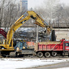 John P. Cleary / The Herald Bulletin<br /> Heavy equipment was busy moving dirt as workers do drainage and site work on the old GM property west of Scatterfield Road.  The city is working on extending East 29th Street through the old Delco factory sites under the CSX rails and aligning it with East 32nd Street for possible development along Scatterfield Road in that area.