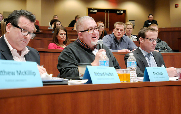 Don Knight / The Herald Bulletin<br /> Collision Cure Body Werks owner Rick Fields asks a question of Pest Away Candles creators Derek Sikorski and Brenton Adcock. Pest Away Candles are designed to keep bugs at bay outdoors.