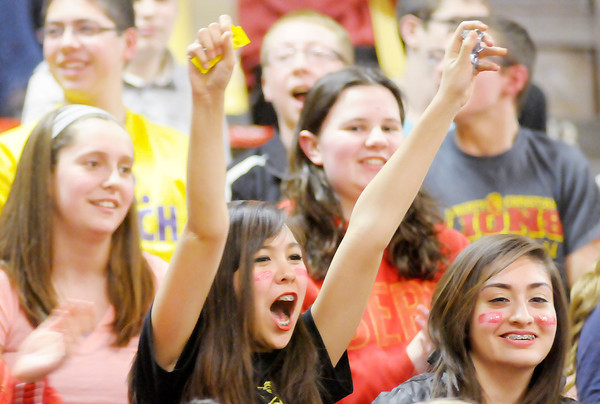 Don Knight / The Herald Bulletin<br /> A Liberty Christian students shows her spirit during a pep rally on Friday. The Lions are traveling to Lafayette for Saturday's semi-state game against Marquette Catholic.