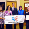John P. Cleary / The Herald Bulletin<br /> Kara Brown of St. Vincent Anderson Regional, Nancy Anderson of St. Vincent Anderson Regional, Danielle Dunnichay-Noone, Kyle Noone, Beth Tharp of Community Hospital Anderson, Ruthie Smith of Community Hospital Anderson, and Sally DeVoe of the Madison County Community Foundation hold up the banner that officially launched Frederick's Friends foundation Tuesday.