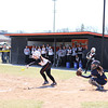 Photo by Chris Martin<br /> The Ravens dugout watches on as Brynn Gooding lays down a bunt Saturday against Franklin College
