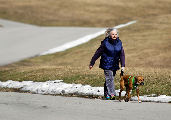 John P. Cleary / The Herald Bulletin<br /> With temperatures up to around 60 degrees people were ready to get outside and enjoy the weather like this couple taking a walk through Mounds State Park Monday afternoon.