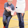 Don Knight / The Herald Bulletin<br /> Sarah Beanson wraps Jeri Tarvin in 2 rolls of toilet paper in a contest to see who was the fastest at wrapping a person in toilet paper during Liberty Christian's pep rally on Friday to fire up their team and student body ahead of Saturday's semi-state game against Marquette Catholic.