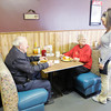 Don Knight / The Herald Bulletin<br /> Audra Carter talks with customers Bob and Mary Ann Welborn at Rachel's Hi-Way Cafe on Thursday. The restaurant has been chosen for a cash mob by the Alexandria-Monroe Chamber of Commerce.