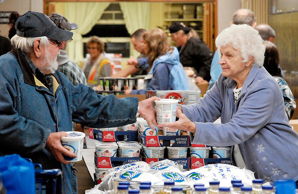 John P. Cleary / The Herald Bulletin<br /> Pantry volunteers help the clients with their food choices.