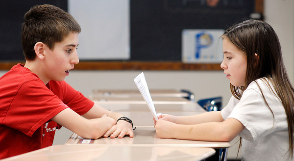 THB photo/John P. Cleary<br /> Siblings Joshua and  Rachel Soden help each other with words as they prepare for the upcoming Herald Bulletin's 2014 Spelling Bee.