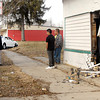 John P. Cleary / The Herald Bulletin<br /> This north bound white vehicle veered off of Arrow Ave. and struck this building at 1628 Arrow Ave. doing damage to both the structure and car Tuesday afternoon around 5 p.m.  A city ambulance and building inspector were called to the scene.